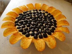 "This idea works for all the sabbats for which sunflowers are correspondences, such as Litha and Lughnasadh. For Lughnasadh, Fritos ""scoops"" would be most appropriate since they are a corn chip."
