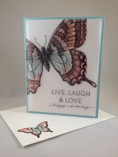 "By Sami Brown. Uses Stampin' Up ""Swallowtail"" stamp. Image stamped in black StazOn ink onto 7"" x 4"" vellum which was scored 1 1/2"" from the top & the bottom. She sponged on the white cardstock to which she attached the vellum piece; but I would just sponge on the back side of the vellum itself. Fold vellum on the score lines & tuck the flaps behind a 4"" x 5"" piece of cardstock. Attach with double-sided tape. Attach all to a card base."