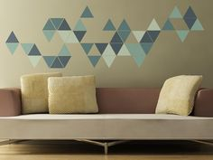 Idea: Place gold paper triangles on wood board behind tv. Leave some triangles plain wood color.