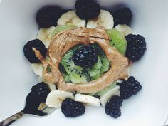 Cooked 1/2 cup #glutenfree oats in 1/2 cup unsweetened #AlmondBreeze with some blueberries on th stove then added a kiwi, banana, blackberries & a spoonful of Trader Joe's almond butter. #dairyfree #vegan Super super good.