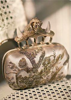 Alexander McQueen gold clutch