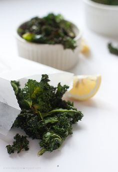 Lemon and garlic kale chips. Iron, calcium, vitamin C, mineral rich and low calorie. #vegan #paleo #glutenfree
