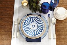 Blue and gold holiday place setting inspiration, featuring Bunny Williams' Campbell House dinnerware and Cobalt Glassware.
