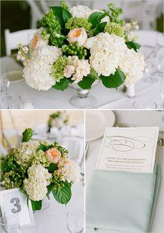 White and green centerpiece with pop of peach. or blush Orlando wedding flowers / www.weddingsbycarlyanes.com