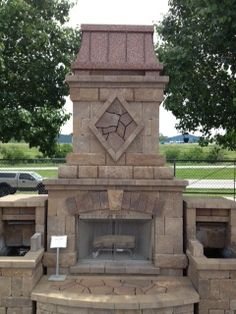 Royale style chimney crown in aged copper from ChimneyKing.com. Outdoor fireplace made from Belgard Bricks.