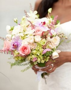 Clutch bouquet with garden picked look of mini green hydrangea, spray roses, matsamoto asters, dendribium orchids,astilbe