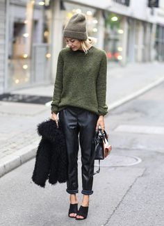 green sweater and leather pants
