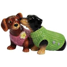 """Westland Giftware Dachshund Sweaters Salt and Pepper Shakers by Westberry Wellness Programs. $11.00. Made of ceramic material. Wonderful gift. Bright and cheery. Exceptional Quality. These adorable """"Mwah."""" salt and pepper shakers feature two Dachsunds in sweaters, and they are even magnetic so they appear to be kissing. These are a great addition to any table. Westland Giftware is known for quality and design."""