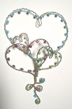 Uplifting bouquet of hearts, seems to float along like balloons! Hand made dimensional wire art hanging design