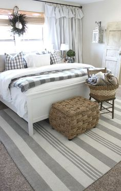Love all the neutral decor - gray stripes, bamboo wall treatment, white curtain