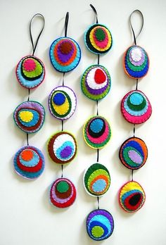 CUSTOM Abstract Felt Mobile by lupin at etsy.  They remind me of peacock feather eyes...
