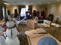 The adventure begins. The Country Door Team unpacks and organizes boxes of holiday décor in the staging area. www.countrydoor.com