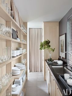 shallow open shelves create feeling of openness in long narrow galley kitchen, provide lots of storage, work best if keep dishes in single colour, clear glassware