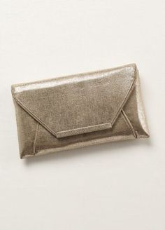 """This gorgeous shimmer envelope clutch is the sleek and stylish accessory you'll need for the perfect night on the town!  Envelope clutch features stunning shimmer detail.  Measures 5 1/2"""" in height and 9 1/2"""" wide.  Available in Gold.  Fully lined. Imported."""