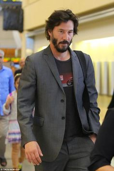 In LAX airport Keanu Reeves, 51, younger than ever showcasing youthful good looks.
