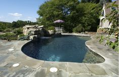 Natural Stone Waterfall and In-Ground Pool