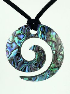 The Maori Koru design is inspired by the New Zealand fern frond unfurling as it grows. It represents peace, tranquility, personal growth, positive change and awakening. Abalone Jewelry, Silver Jewelry, Gold Jewellery, Crystal Jewelry, Silver Ring, Paua Shell, Abalone Shell, Shell Pendant, Tattoos