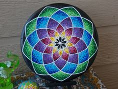 Round Mandala Painting on Wood ~~~~ Comes with Stand  Pointillism Hand Painted Mandala done with many small dots that blend and create a beautiful textured pattern. Painted with Acrylic paints on a 6 inch round wooden disk. I have applied a protective clear coat to this painting. This mandala comes with a small easel for displaying wherever you want. Perfect for adding color and energy to any space, home, office or dorm. This painting will be packaged with care and sent in a padded envelope…