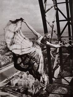 """Erwin Blumenfeld (1897-1969)"" at Jeu de Paume, Paris. October 15, 2013–January 26, 2014. Pictured: Lisa Fonssagrives on the Eiffel Tower, Paris, 1939. © The Estate of Erwin Blumenfeld   Photo: Erwin Blumenfeld"
