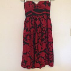 """Tibi dress Red and black floral Tibi dress. Size 8. Has built in bra. Measures 34"""" from armpit to hem. Tag is marked to prevent returns. Silk and wool. Tibi Dresses Midi"""