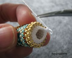 Bead crochet tutorial using size 80 DMC thread (Ukośnik). Bead Crochet Patterns, Bead Crochet Rope, Beaded Jewelry Patterns, Beaded Crochet, Crochet Beaded Bracelets, Beaded Crafts, Crochet Earrings, Beadwork Designs, Beads And Wire