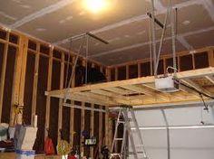 Find more inspiring images about building a storage loft in garage on our site. Find more inspiring images about building a storage loft in garage on our site. Overhead Garage Storage, Garage Storage Solutions, Diy Garage Storage, Garage Shelving, Garage Shelf, Garage Organization, Garage Doors, Storage Ideas, Kitchen Storage