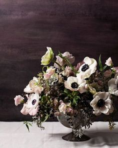 Barely Blushing Anemone Centerpiece   Tara Donne Photography   Ivory and Ink - A Moody and Dramatic Industrial Wedding Palette