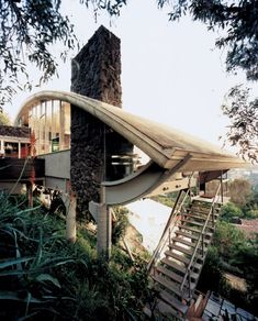 by amazing atomic age mid-century modern architect John Lautner: Garcia Residence a. The Rainbow House. This architect builds as close as you'll get to the Jetson's pod! Unusual Buildings, Interesting Buildings, Beautiful Buildings, Beautiful Homes, John Lautner, Architecture Unique, Interior Architecture, Classical Architecture, Rainbow House