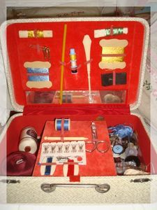 A vintage child's suitcase used as a sewing basket. So portable. A great gift for sewing friends! ... OR ME~~