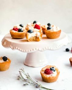 """The warmer spring weather calls for easy desserts, highlighting the freshest fruit of the season. In this Sugar Cookie Fruit Tarts recipe, sugar cookies serve as the base for this easy, one-bite dessert. Layered with a sweetened cream cheese filling and topped with fresh berries, these Sugar Cookie Fruit Tarts will be the hit of the backyard bbq! These are also one-bite desserts which require no utensils (or even plates!). The components include a """"cup"""" made from the dough of my super easy…"""