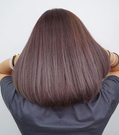 Simple, sophisticated, stylish Smooth ash violet color tones on mid-length hair by Number76 Singapore.