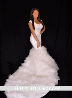 Kim Kardashian inspired mermaid wedding dress with detachable princess ball gown. (custom order only). $1,500.00, via Etsy.