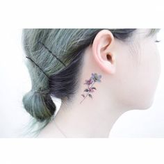 Anemone tattoo behind the right ear. Tattoo artist: Banul