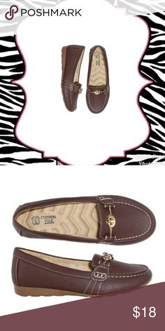 Jazzy Turn-lock loafer NEW MATERIALS • Upper-Brown Polyurethane • Lining- Natural faux suede Polyurethane • Sock-Natural faux suede Polyurethane • Outsole- Brown thermal plastic rubber  CARE • Wipe with a dry cloth. Storage item #: B1 Avon Shoes Flats & Loafers