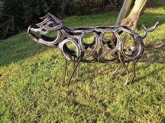 Pig made from horse shoes