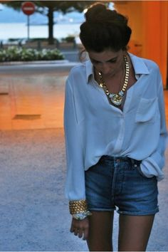 effortless date night: white silk blouse, denim shorts, statement necklace, gold cuff