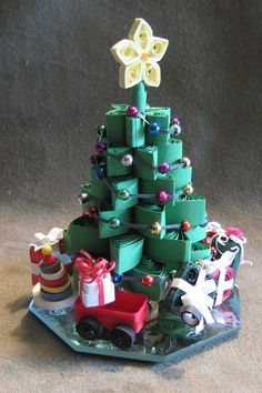 One of my first trees....All paper excepts the bead 'lights' and the mirror base. By Cathy Schlim