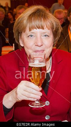 Demmin, Germany. 18th Feb, 2015. German Chancellor #AngelaMerkel enjoys a #beer during 20th political Ash Wednesday in DemminCredit: dpa/Alamy Live News