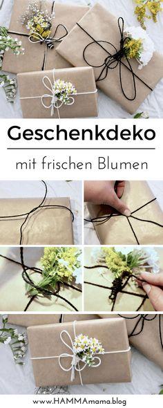 Geschenke schön verpacken mit frischen Blumen. #Geschenkeverpacken #Geschenkdeko #Blumen #Geschenkpapier