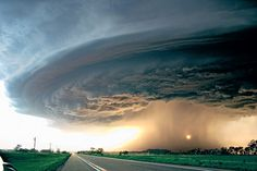 """A cloud over Sioux City, Iowa, is whipped into a massive, spaceship-like doughnut a mile in diameter."""