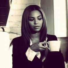 Beyonce' drinking coffee