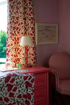 The Weymouth Table Lamp shown with The Hurlingham Desk, The Moonback Chair, Coral Pink wallpaper and Tulips and Butterflies curtains, all by Soane Britain. Botanical Wallpaper, Pink Wallpaper, Hand Printed Fabric, Brass Table Lamps, Oriental Pattern, Big Girl Rooms, Bedroom Furniture, Interior Design, Metal Finishes