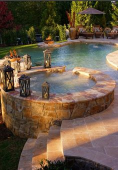 I can see some teak benches and stools, or chairs creatively placed around this water feature...