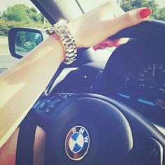 Girl driving BMW