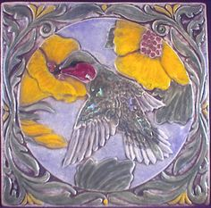 Decoratve relief carved ceramic humming bird by earthsongtiles