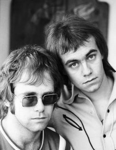 Elton John and Bernie Taupin.  Just so it's known, their relationship was entirely a songwriting partnership as Bernie is not gay.