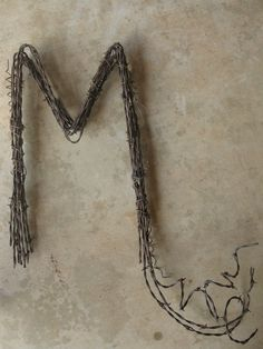 Hey, I found this really awesome Etsy listing at https://www.etsy.com/listing/163262847/barbed-wire-letter-m