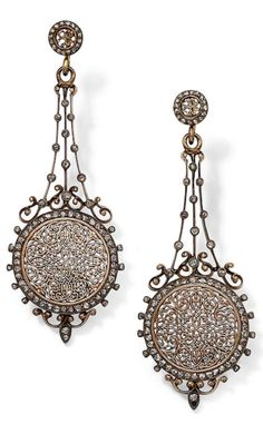 A pair of antique diamond pendent earrings, circa 1880. Each delicately pierced circular plaque within a border of rose-cut diamonds, to a gently tapering knifewire trellis set with similarly-cut diamonds and a circular surmount of similar pierced design, length 6.0cm. #antique #earrings