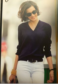 Vintage Ines de La Fressange in navy blue vee-neck sweater and white jeans
