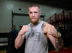 TORRENCE, CA - FEBRUARY 24: UFC featherweight champion Conor McGregor poses after a news conference with lightweight contender Nate Diaz at UFC Gym February 24, 2016, in Torrance, California. (Photo by Kevork Djansezian/Getty Images)